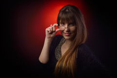 Young woman portrait holding eyeglasses Royalty Free Stock Photos