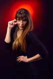 Young woman portrait holding eyeglasses Royalty Free Stock Image