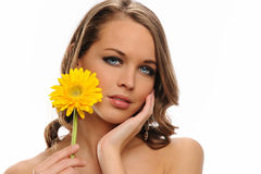 Young Woman portrait holding a yellow flower Royalty Free Stock Images