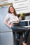 Young woman portrait in the kitchen Royalty Free Stock Photography