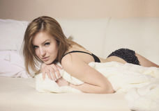 Young woman portrait lying in her bad early morning Royalty Free Stock Image