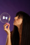Young woman portrait making soap bubbles Stock Photography