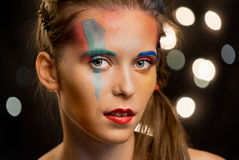 Young woman portrait, multicolor face painting. Model with make up. Girl with art paint Stock Photography