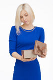 Young woman portrait opening gift Royalty Free Stock Image