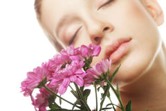 Young woman portrait with pink chrysanthemum. Spa treatment royalty free stock photos