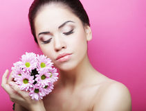 Young woman portrait with pink chrysanthemum Royalty Free Stock Images