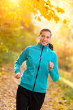 Young woman portrait, running in morning sun Royalty Free Stock Photo