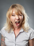 Young woman portrait, shouting Royalty Free Stock Photos