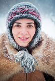 Young woman portrait in the snow Stock Photos