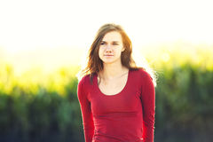 Young woman portrait in sunlight on nature Stock Photos