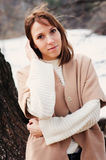 Young woman portrait on the walk in autumn forest in beige coat Stock Photography
