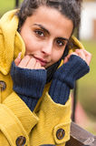 Young woman portrait in yellow coat fall Stock Image