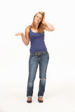 Young woman poses with shrugged shoulders Stock Image