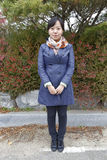 Young woman poses - South Korea, National Capital Area, Seoul - NOVEMBER 2013 Royalty Free Stock Photos