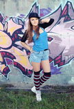 Young Woman Posing against Graffiti Stock Photography