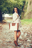 Young woman posing with a bag in hand Stock Image