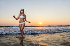 Young woman posing on beach at sea Stock Photo