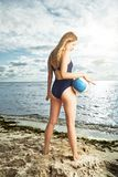 Young woman posing on the beach with volleyball Stock Image