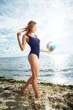 Young woman posing on the beach with volleyball Stock Photos