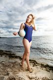 Young woman posing on the beach with volleyball Royalty Free Stock Photos