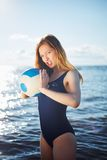 Young woman posing on the beach with volleyball Royalty Free Stock Image