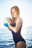 Young woman posing on the beach with volleyball Stock Photography