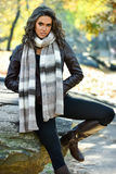 Young woman posing in beautiful autumn park. Young woman posing in beautiful autumn park, concept autumn. Fall fashion royalty free stock image