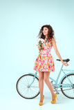 Young woman posing with bicycle Royalty Free Stock Photo