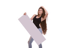 Young woman posing with big nameplate or empty blank isolated on white background. Smyling young woman with long hair posing with big nameplate or blank isolated Royalty Free Stock Photography