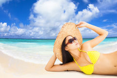 Young woman posing in bikini on the beach Royalty Free Stock Photography