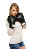 Young woman posing with boxing gloves Stock Photography