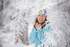Young woman posing at camera in winter mountains Royalty Free Stock Photo