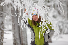 Young woman posing at camera in winter mountains Stock Image
