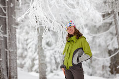 Young woman posing at camera in winter mountains Royalty Free Stock Image