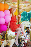 Young woman posing on a carousel Royalty Free Stock Image