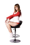 Young woman posing on a chair Royalty Free Stock Photo