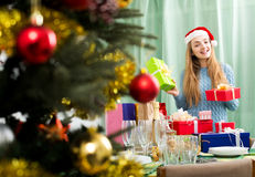 Young woman posing with Christmas gifts Royalty Free Stock Images