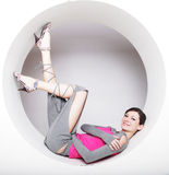 Young woman posing  in a circle Royalty Free Stock Image