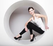 Young woman posing  in a circle Royalty Free Stock Photos