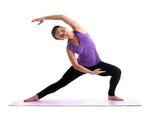 Young woman posing in color fitness costume Stock Photos