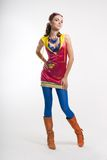 young woman posing in color wear Stock Image
