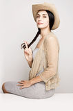 Young woman posing in cowboy hat Royalty Free Stock Image