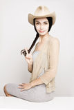 Young woman posing in cowboy hat Stock Images