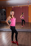 Young Woman Posing in Dance Studio with Mirrors Stock Images