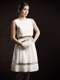 Young woman posing in designer skirt and top Royalty Free Stock Photo