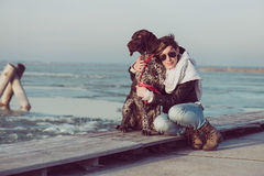 Young woman posing with dog outdoor Royalty Free Stock Photography