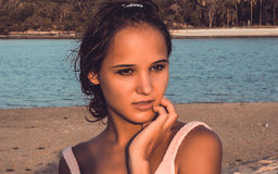 Young woman posing in dress on the beach Stock Photography