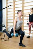 Young woman posing exercise with dumbbells in gym Royalty Free Stock Photo