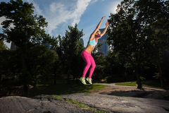 Young Woman posing and Exercising. In Central Park, NYC on a beatufiul Summer day Royalty Free Stock Photography