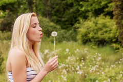 Young woman posing with flowers . Outdoor shot. Royalty Free Stock Photo
